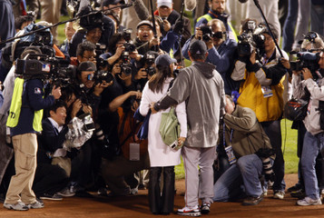 Boston Red Sox Matsuzaka is photographed during celebrations after his team's victory over the Colorado Rockies to win Major League Baseball's World Series in Denver