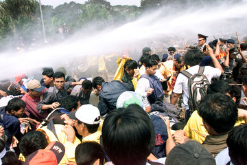 INDONESIAN POLICE FIRE WATER CANNONS AT STUDENTS OUTSIDE PARLIAMENT INJAKARTA.
