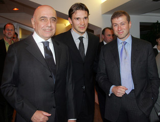 A.C. Milan's soccer star Shevchenko poses with Galliani and Abramovich after the press conference at ...