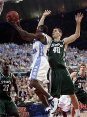 North Carolina guard Felton puts up shot gainst Michigan State center Davis during NCAA Final Four.