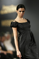 """A model presents a creation from Moschino's Autumn/Winter collection at the """"Walk of Fame"""" fashion show in Manama"""