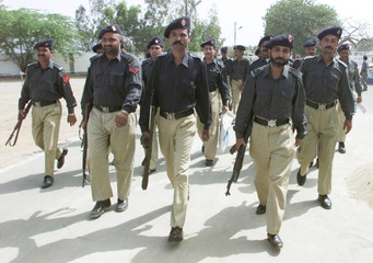 A CONTINGENT OF PAKISTANI POLICE PATROL THE PREMISES OF CENTRAL JAIL INKARACHI.