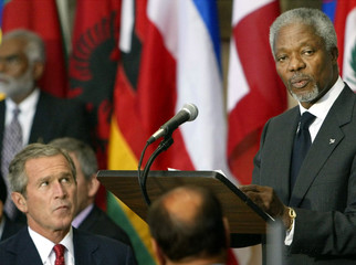 U.S. President George W. Bush listens as United Nations Secretary General Kofi Annan speaks during a..