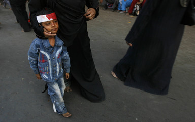 A Muslim boy has his head bandaged during a Moharram procession on the occasion of Ashura in Mumbai