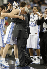 North Carolina coach Williams hugs Hansbrough near end of game against Michigan State during their NCAA men's Final Four championship game in Detroit