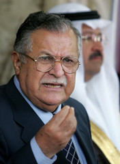 Iraqi President Jalal Talabani speaks to reporters after meeting with vice presidents in Baghdad.