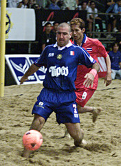 ERIC CANTONA FIGHT FOR A BALL DURING THE BEACH SOCCER FRIENDLY MATCH IN BANGKOK.