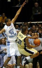 The University of North Carolina's Brandan Wright defends as Georgia Tech's Jeremis Smith goes to the basket in Chapel Hill