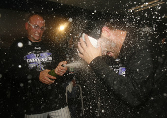 Colorado Rockies Holliday sprays Cory Sullivan with champagne in the dressing room in Denver