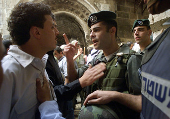 PALESTINIANS ARGUE WITH ISRAELI POLICE AS THEY ARE DENIED ACCESS TO MOSQUE IN JERUSALEM.