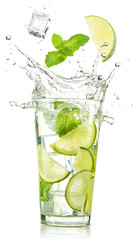 lime and mint falling into a cocktail splashing