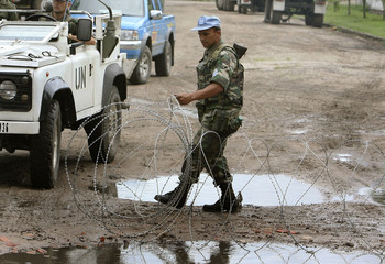 U.N. soldier moves barbwire near the office of Congo's Vice President Jean-Pierre Bemba in Kinshasa