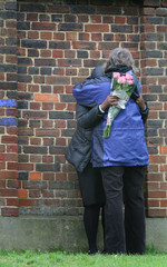Pupil is consoled as she arrives at school following murder of schoolboy at London Academy in Edgware
