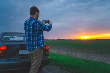 man taking picture of sunrice