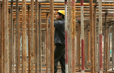 Man works on the scaffold at construction site in Beijing