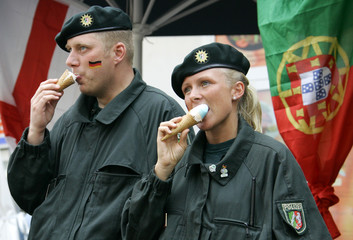 German police officers eat ice cream in the centre of Gelsenkirchen