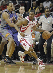 Houston Rockets' Tracy McGrady dribbles away from the corner of the court past Phoenix Suns' Shawn Marion,