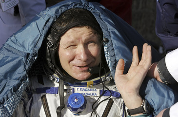 Russian cosmonaut Gennady Padalka waves after he returned in the Russian Soyuz space capsule near the town of Arkalyk