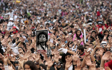"A picture of Michael Jackson is seen as thousands of his fans dance to ""Thriller"" in celebration of the late singer's 51st birthday in Mexico City"