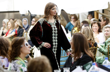A model displays a traditional Moroccan dress a during a fund raiser fashion show for a local charity in Amman