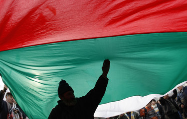 Demonstrators shout anti-government slogans in front of the Bulgarian Parliament building in Sofia