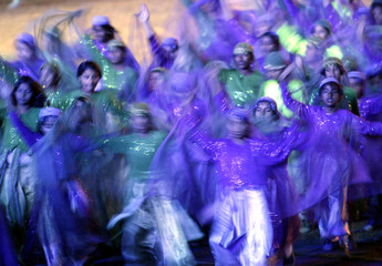 PAKISTANIS PERFORM DURING THE OPENING OF SOUTH ASIA FEDERATION GAMES IN ISLAMABAD.