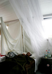 An Acehnese patient lies on a bed at German rescue centre in the tsunami-hit city of Banda Aceh.