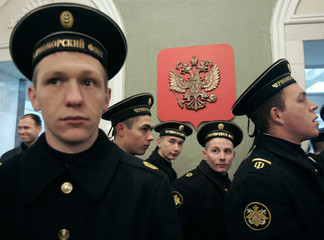 Sailors of Russia's Black Sea fleet stand at a polling station in the Ukrainian Black Sea port of Sevastopol