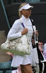 Maria Sharapova of Russia  wallks onto the court before her match against Viktoriya Kutuzova of Ukraine at the  Wimbledon tennis championships in London