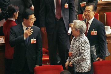 China's President Hu talks to Vice Premier Wu as Premier Wen listens in Beijing