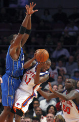 New York Knicks' Crawford is blocked by Orlando Magic's Howard in their NBA game in New York
