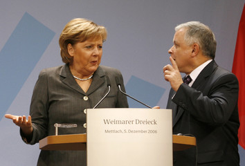 German Chancellor Merkel and Poland's President Kaczynski gesture before a news conference during a one-day-summit in the southwestern German town of Mettlach