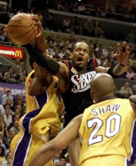ALLEN IVERSON AGAINST LAKERS DEFENDERS DURING NBA FINALS GAME 1.
