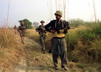 PAKISTANI TROOPS PATROL NEAR WAGAH ON PAKISTAN INDIAN BORDER.