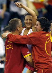 Spain's Nuria Llagostera Vives celebrates her win against China's Peng Shuai during the Fed Cup world group semi-final match at the Beijing International tennis centre