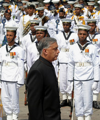 Pakistan's Prime Minister Shaukat Aziz inspects the Sri Lankan navy Guard of Honour in Colombo.