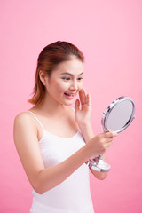 Face of young beautiful healthy asian woman and reflection in the mirror