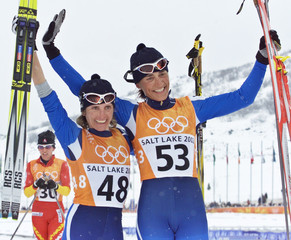 ITALIANS PARUZZI AND BELMONDO CELEBRATE THEIR MEDALS IN WOMENS 30 KMCLASSICAL CROSS COUNTRY EVENT.