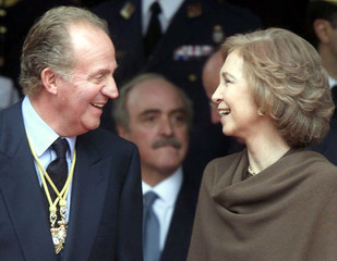 SPANISH KING JUAN CARLOS SHARES A LAUGH WITH QUEEN SOFIA.