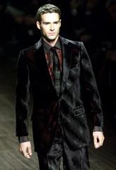 A MODEL WEARS AN OUTFIT AS PART OF VALENTINO AUTUMN/WINTER MEN'S COLLECTION IN MILAN'S FASHION SHOWS.
