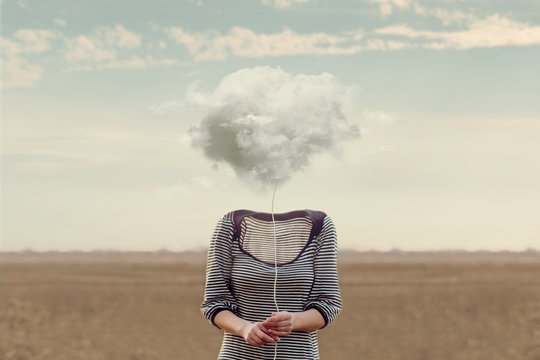 Woman's head hidden by a soft cloud
