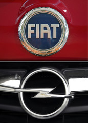 A combination of file pictures shows the logos of the Fiat Panda and of an Opel car