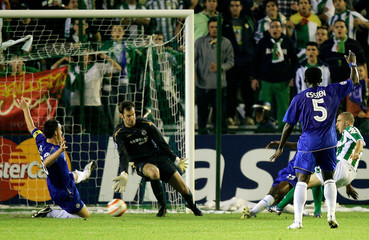 Real Betis' Dani beats the Chelsea defence to score during their Champions League soccer match in Seville