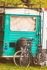 Vintage blue motorhome with bicycles in front