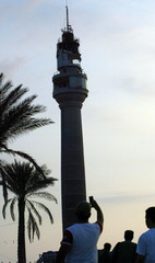 Man takes picture of Beirut's lighthouse after it was bombarded by Israeli warship