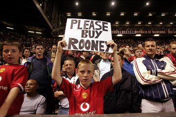 A Manchester United fan holds a banner during their Champions League match against Dinamo Bucharest at ...
