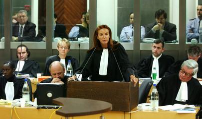 Belgian Martine Van Praet (C), a lawyer for convicted child killer Marc Dutroux (background, 2nd R) ..