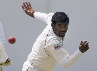 Sri Lanka's Muttiah Muralitharan bowls on the second day of the first test cricket match against New Zealand in Christchurch