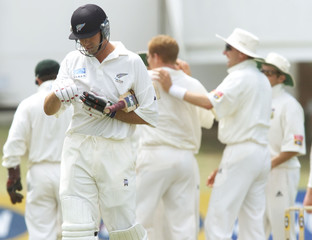 NEW ZEALAND CAPTAIN STEVEN FLEMING DEPARTS AFTER LOSING HIS WICKET AGAINST SOUTH AFRICA.