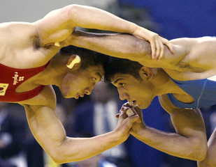 BAEK OF SOUTH KOREA COMPETES AGAINST DABIR OF IRAN DURING THE FREESTYLE 66 KG CATEGORY ...